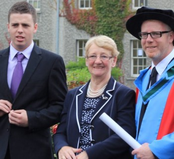 Prof. McInerney, his mother and son at his DSc conferring in 2013